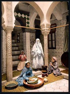 Moorish women preparing couscous, Algiers, Algeria ca 1899