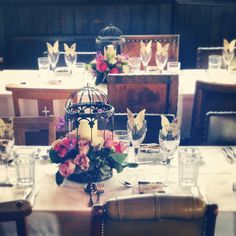 Beautiful birdcage flower and candle centerpieces at The Battleaxes