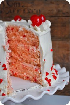 Cherry Almond Sour Cream Cake Recipe ~ This beautiful and whimsical cake is perfect for any occasion! Filled with a cherry-flecked frosting and topped with an amazing flour-based buttercream, this cake is sure to be a people-pleaser!