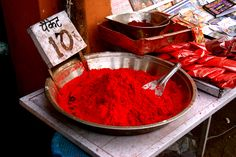 Bowls of red spices at the market