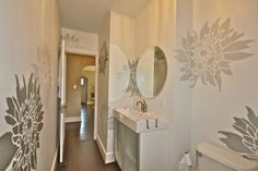 Hand-stenciled bathroom walls... a dramatic addition that is unique and distinctive.