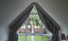 Image result for how to dress a triangular window with curtains