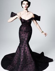"""Zac Posen upped the glamour ante with his latest collection for Pre-Fall  2013. If I had some enchanted holiday ball to attend this weekend, I'd most  definitely pick one of these curve-hugging gowns. The collection is all  about drama, or in Zac's words, """"Maria Callas going to Argentina.""""      Posen used the words anatomical and architectural to describe the     season. He approaches his designs almost like an architect would,     adding fiber optics to organza and tulle, for example, so…"""