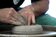 Opening up a centred lump of clay on the potters' wheel | Dan Wainman at the Kingston Potters' Guild | Photographed by Brendan Cull