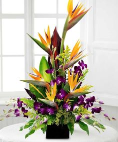 Birds in Paradise.exotic arrangement of Birds of Paradise with vibrant purple dendrobium orchids and lush greenery. Beneva Flowers - Sarasota,FL Love this dynamic color combination. Tropical Flower Arrangements, Church Flower Arrangements, Beautiful Flower Arrangements, Silk Flower Arrangements, Flower Centerpieces, Beautiful Flowers, Simply Beautiful, Exotic Flowers, Large Flowers