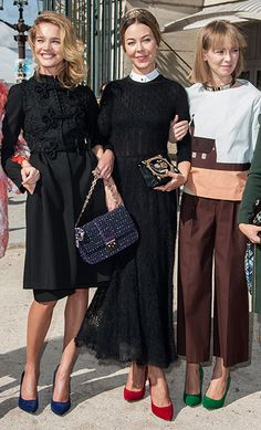 Ulyana Sergeenko with Natalia Vodianova and I am not sure who the third person is.  Check out their multi-colored shoes!  Now these are fashionistas!
