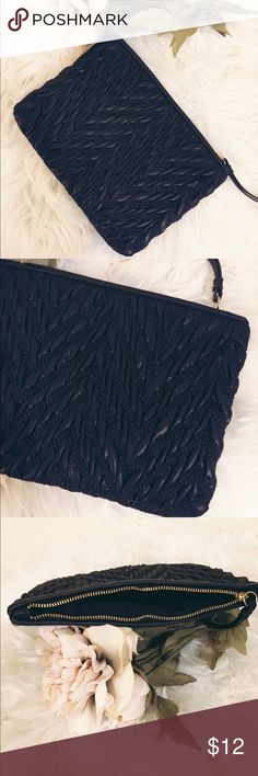 Banana Republic Black Mini Clutch Black mini textured clutch from Banana Republic  Excellent used condition Gold Top zipper  Faux Leather and Poly material  6h X 8L Banana Republic Bags Clutches & Wristlets