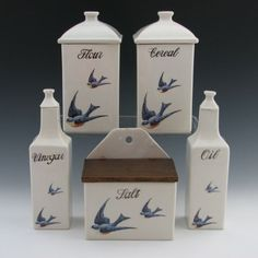 Hull Bluebird Canisters, Jars, Cruets, Salt Box Very rare complete set of Hull Bluebird canisters (coffee, flour, rice, tea, cereal, sugar), spice jars (nutmeg, pepper, ginger, mustard, cinnamon, allspice, vinegar and oil cruets and lidded salt box. Unmarked (typical).