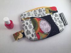 This zipper pouch is a patchwork of some of my favorite fabrics. Theres a black-and-white birdcage fabric, an upholstery black fabric with bright flowers, and a starry white polka dot on black. The peek-a-boo window features a faded grey daisy cotton. The pouch is reinforced with interfacing