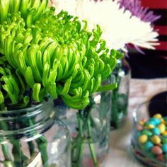 Easy, inexpensive Easter arrangement! Flowers (I spent less then $20), and three mason jars.