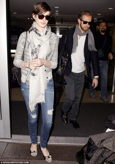 Smart casual: The Les Miserables star kept her head down as Adam followed closely behind