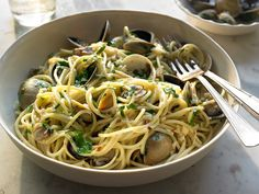 For me, spaghetti with clams has to be ''white,'' which is to say without a tomato in sight -- and actually the first time I ate it this way was not in Italy but in one of my favorite Italian restaurants in New York, Da Silvano This was a very long time ago, and I've been hooked ever since I have specified amounts for a single portion here, because I feel cooking food you love is never something that should be reserved for company