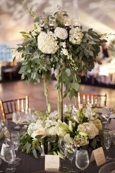 tall centerpiece with tea candles, would prefer peach peonies