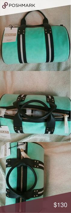 Behati Juicy Couture overnight bag Brand new overnight bag from Juicy Couture.  A mint green or aqua color with black strips. Side panels are faux black leather. Bag was purchased from juicycouture.com.   Willing to accept reasonable offers. Juicy Couture Bags Travel Bags