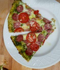 Pizza with arugula walnut pesto