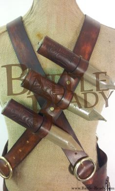Custom made baldricks, with stakes. All hand tooled. With attachments on sides to fit custom scabbard, crossbow and quiver.  Stakes Made by Eldritch.  View more at www.Battle-Ready.com Visit us on Facebook www.facebook.com/BattleReady