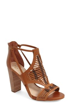 Vince Camuto combines woven leather, chic cutouts, and an architectural stacked heel for a western vibe.