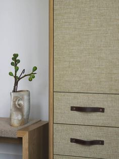 Linen cabinet fronts.  Leather strap pull.  An Eco-Conscious Hotel in New York : Remodelista