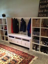two IKEA Expedit bookcases and an IKEA Hemnes TV Stand in the center. Alternative use for our tv stand? Ikea Expedit Bookcase, Mudroom, Home, Ikea Hemnes, Ikea, Ikea Bookcase, Home Diy, Ikea Mud Room, Hemnes Tv Stand