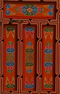 The door of a Mongolian ger, adorned with colorful patterns. The door of the ger is always facing South. www.stonehorsemongolia.com