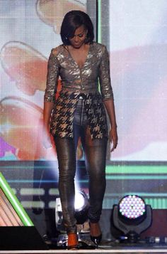 """""""OUR first lady? At a Kids' Choice Awards, Michelle Obama wore an outfit designed by New York-based, uber-expensive designer, Wes Gordon. His clothing commands prices only for the SUPER wealthy. What a HORRIBLE ROLE MODEL! Michelle Et Barack Obama, Michelle Obama Fashion, Malia And Sasha, Kids Choice Award, Choice Awards, First Black President, Mode Costume, Black Presidents, Leather Trousers"""