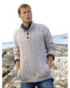 Made from 100% Merino Wool. This man's button sweater is crafted using traditional Irish Aran Fisherman knitting patterns from Ireland.  Colours Available: Oatmeal and Charcoal.