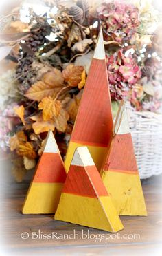 DIY - Wood Candy Corn - cut triangles; sand; paint yellow, orange & white...