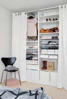 Compact wardrobe with curtain