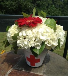 Terra Cotta pots painted and stenciled. Filled with white Hydrangea's and  red dahlia flowers.