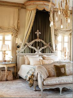 Actually, their master bedroom at Cal-a-Vie is dressier than the Houston bedroom. That's a surprise.  Love the shades!!!  And love the chandelier – and the lamps!  Wow, Michael Smith fabric was used on the bed – another surprise!