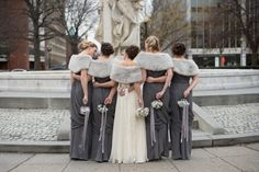 winter wedding bridesmaids dresses, matching dark grey draped back dresses with grey faux fur stoles and a white chiffon style wedding dress, plus ribbon details on the circular bouquets Romantic Bridesmaid Dresses, Grey Bridesmaids, Wedding Dresses, Grey Winter Wedding, Winter Wonderland Wedding, Charcoal Wedding, Winter Wedding Inspiration, Wedding Ideas, Diy Wedding