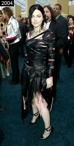 Evanescence singer Amy Lee may have just started out with a bubble-gum pink princess dress. But when she decided to goth it up with a roll or two of electrical tape and then randomly rip the bottom, it went downhill fast.