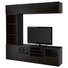 Discover our affordable range of TV wall units. Find TV storage units in different sizes, styles and materials at IKEA. Shop online and in-store. Tv Storage Unit, Storage Spaces, Storage Systems, Shelving Units, Wall Units, Record Storage, Tv Units, Extra Storage, Storage Shelves