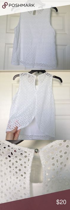 NWOT Tulip Back Tank NWOT.  Purchased for $36 from Dillards and cut the tag off but never wore. White tank top with eyelet cutout design throughout. Front is lined. Tulip back design which is unlined and see-thru as shown in photo 1. Small keyhole opening at back of neck with silver button (photo 3). Cute for festival season! one clothing Tops Tank Tops