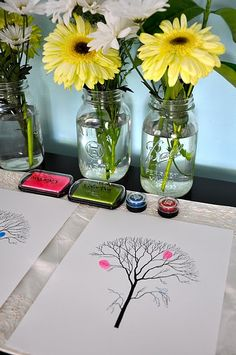 Instead of a traditional guest book ...printed out trees where the guest use their finger prints to make leaves on the tree.  You could make different colored trees and hang them in a trio. mason jar flowers