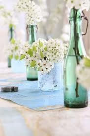 Flowers in green bottles and jars