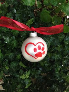 Items similar to Red Paw Print Christmas Ornament - Pet Lover Bauble - Personalized Dog or Cat, Heart - Vet Appreciation, Pet Memorial, Heart Paw Print on Etsy Painted Christmas Ornaments, Dog Ornaments, Noel Christmas, Christmas Animals, Christmas Cats, Homemade Christmas, Christmas Bulbs, Christmas Decorations, Memorial Ornaments