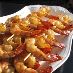 Grilled shrimp are quickly marinated in a spiced tomato sauce, then grilled--either indoors or out. A big hit with company, and easy to prepare.
