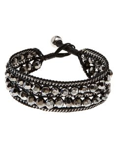Up your glam factor with this boho chic fabric bracelet embellished with sparkling metal beads