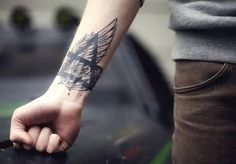 Forearm Tattoo Ideas and Designs 71-Wing Tattoo + Earth and air symbol