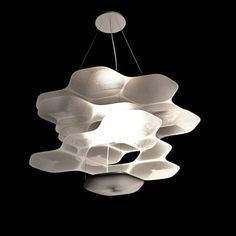Artemide's Space Cloud fixture by Ross Lovegrove is an LED suspension lamp made of four layers of anodized aluminum that reflect the light e.