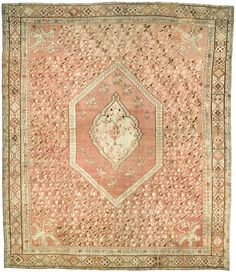 A Turkish Ghiordes rug BB0319 - by Doris Leslie Blau.  A late 19th century antique Ghiordes (Giordes) rustic carpet the faded pinkish brown field with floral sprays around ...