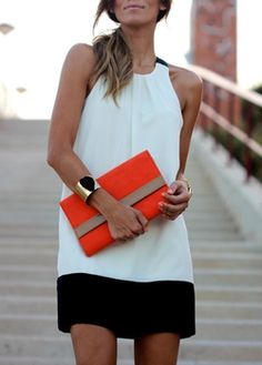 Classic black and white broken with a bold burnt orange clutch.