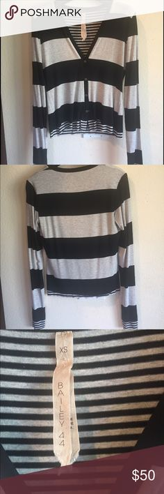 Bailey 44 striped cardigan Beautiful Bailey 44 black and white striped cardigan. Only worn a handful of times and in EUC. There are 4 little buttons down the front- looks good open or closed. Size is XS but runs  a little big.  Super soft and lightweight. Feel free to ask any questions 🌸🌺 Bailey 44 Tops