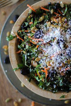 Kale salad with pepitas, dried cherries, cotija cheese, and lemon-parsley dressing.