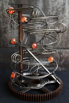 """Industrial Style Rolling Ball Sculpture - Letter """"R"""" frame"""