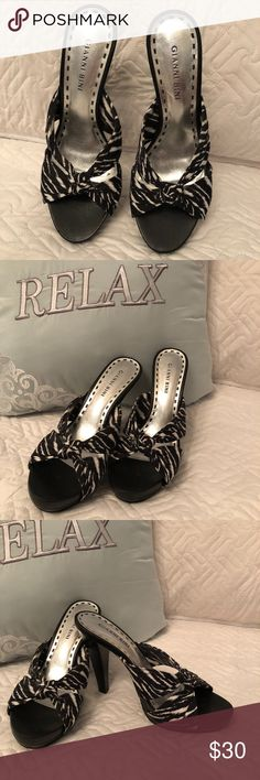 """Zebra pattern Gianni Bini Stiletto pumps, 7 1/2 Stylish stiletto pumps with a criss cross knotted fabric zebra print to slip on your foot.  Super cute and sexy.  Platform 1"""", heel 4 1/2"""". As you can see by the photos, these do not even look worn; however, they have been gently used but there is no damage to the shoe.  Perfect shoe for date night, party or simply showing off your beautiful feet and allowing the world see how amazing you look in these shoes.  Ready to be packaged and shipped…"""