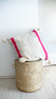 Moroccan POM POM pillow cover , wool natural undyed with different colored bands.Handwoven in Morocco on traditional wooden looms, this long wool cushion is a bright statement accessory to your home: Color: Ecru with Pink and blue bands.: Size: 60x60 cm (approximately).: Material: Wool.: Metal Zip Closure.: Handmade in MoroccoThese pillow are sent without filling for comfort. Unstuffed pillow are smaller, lighter.Wash at 30 degrees./. Please all...