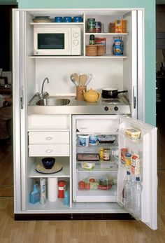 Mini kitchen for studio apartment HAHA THIS WOULD NEVER WORK FOR ME BUT HOW CUTE!