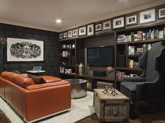 """Make a bold statement  Dark and dramatic, black can make a strong statement in a room.  """"We really only have one area that is solid black — and that is the dining room ceiling, which is a backdrop for our stunning brass chandelier,"""" she says.  Since the library is across from the dining room, I wanted to accentuate the shape and height of the ceiling in here, too.  Design approach: The black built-in serves as a frame for the shelves that are full of colorful books, while also providing a…"""